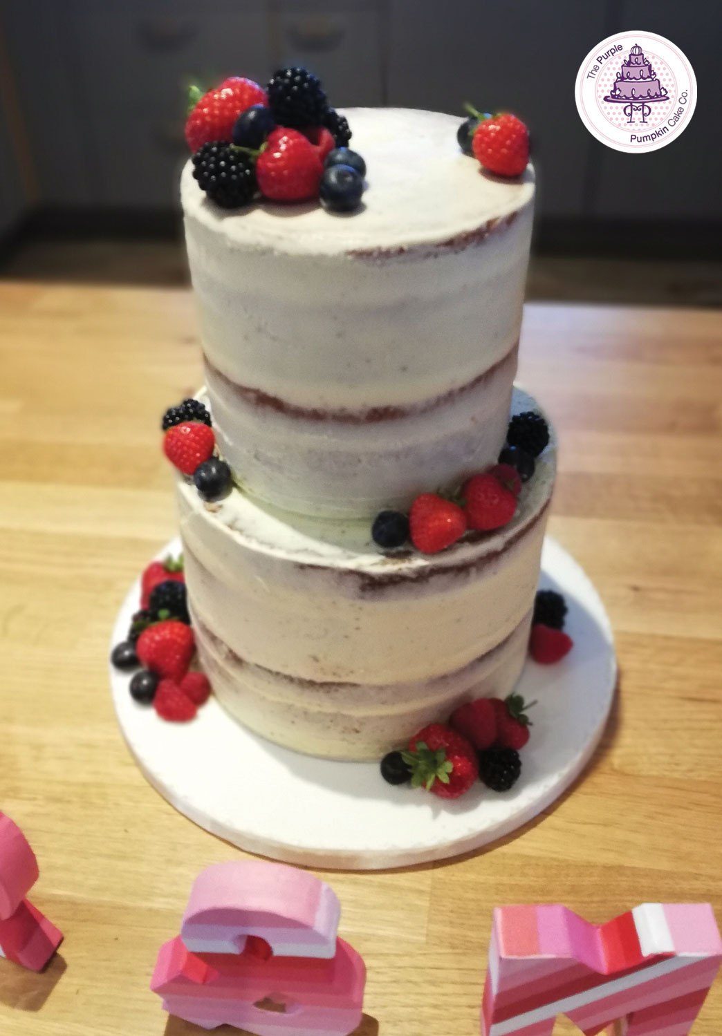 Two tier semi naked and fruit