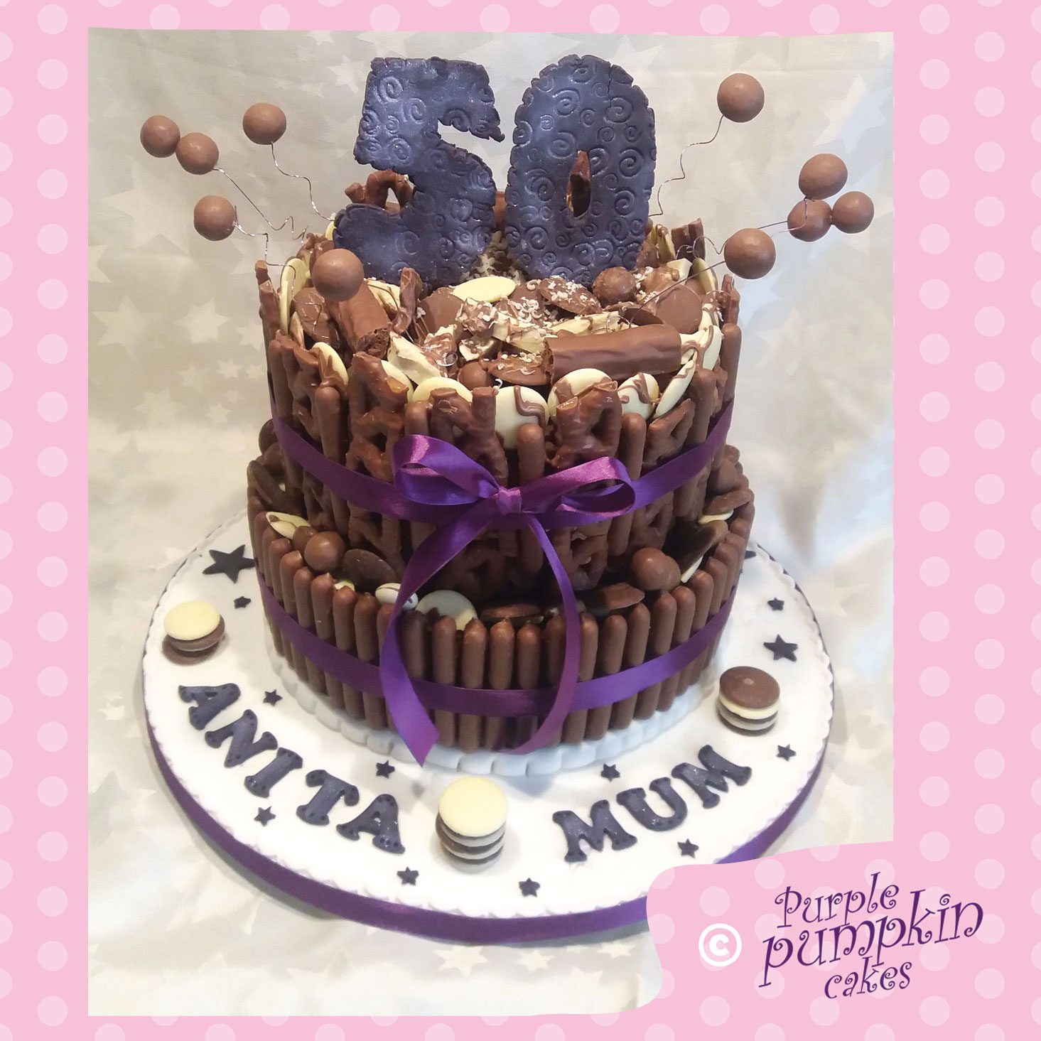 two tier purple choctastic cake