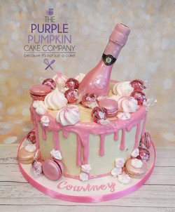 Pink drip cake with bottle