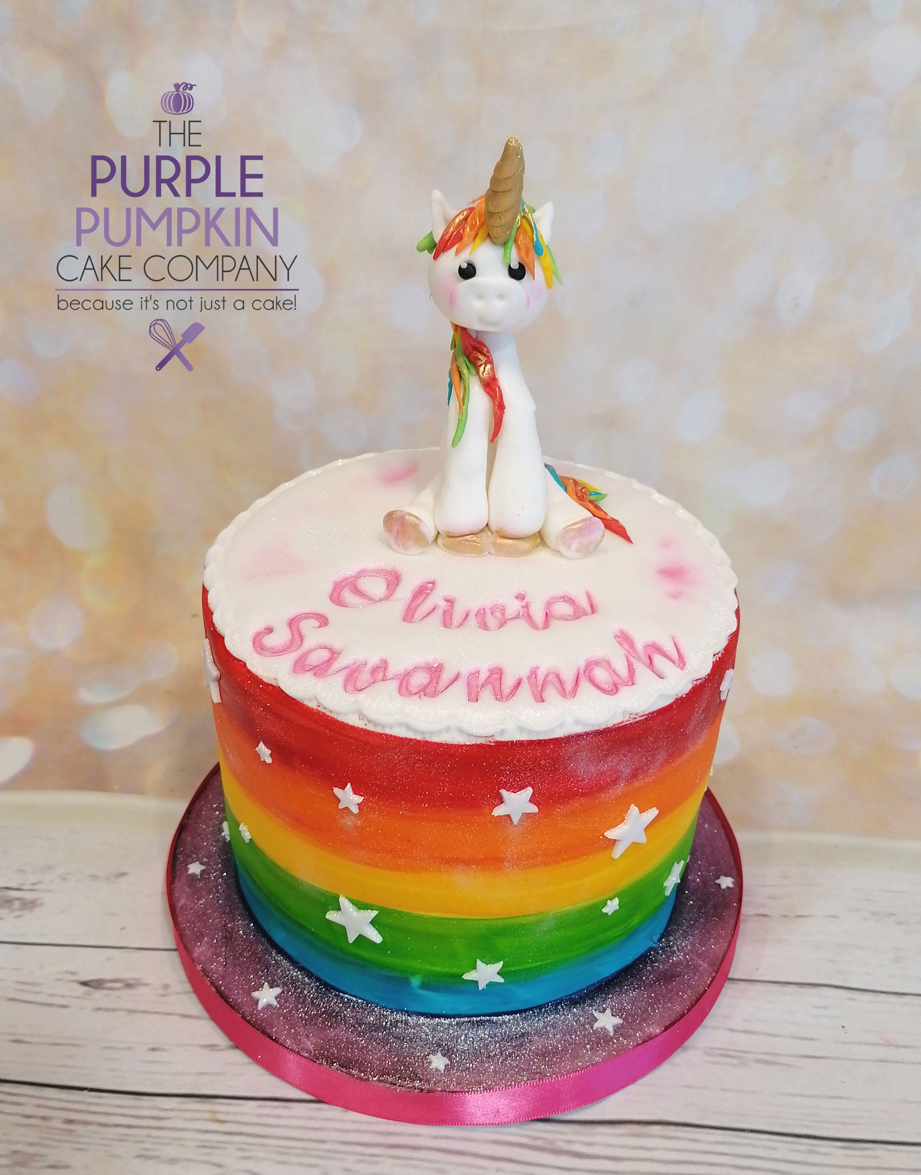 Rainbow striped unicorn gluten free cake