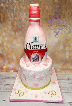 Pink gin bottle cake