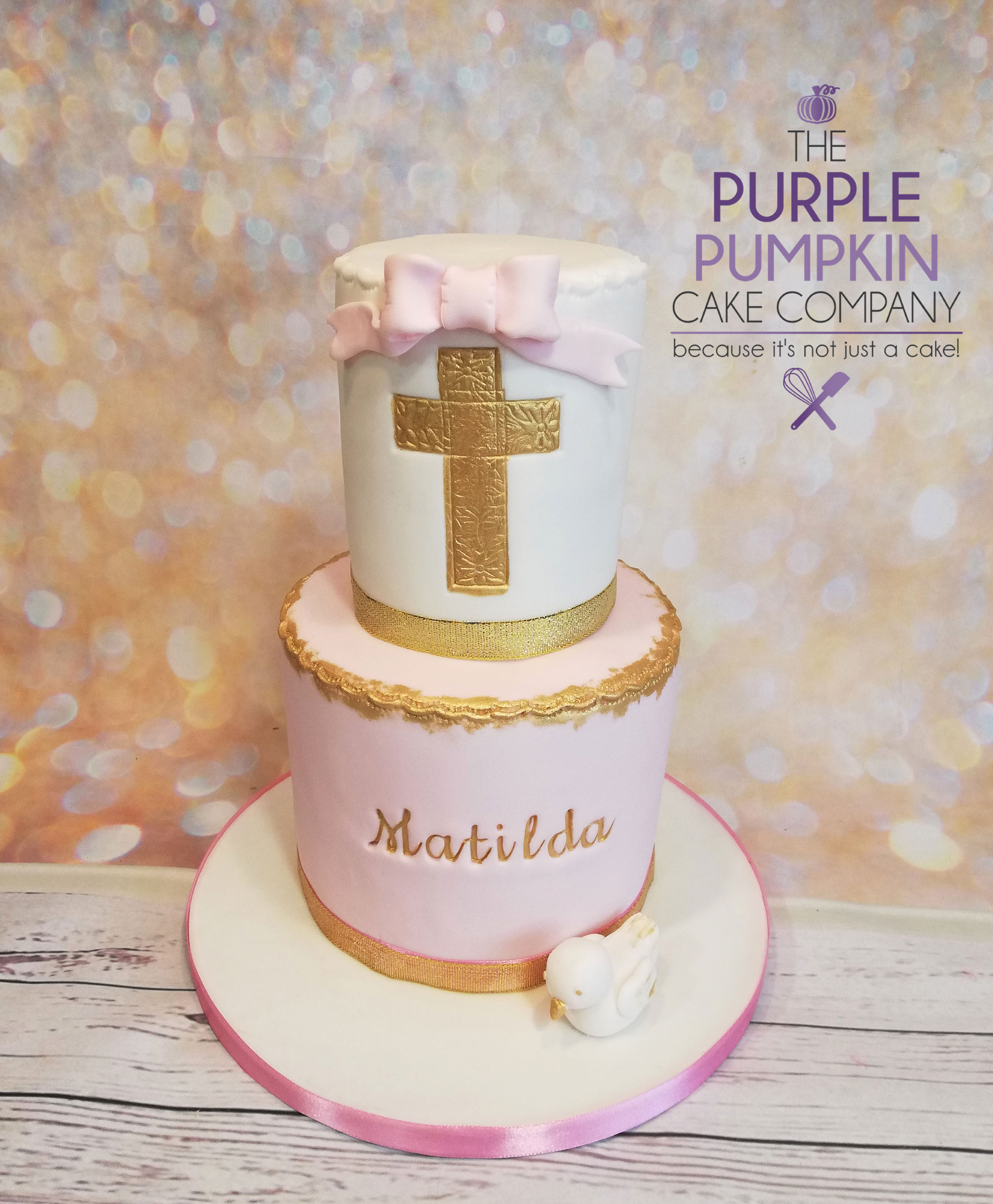 Pink and gold cross cake