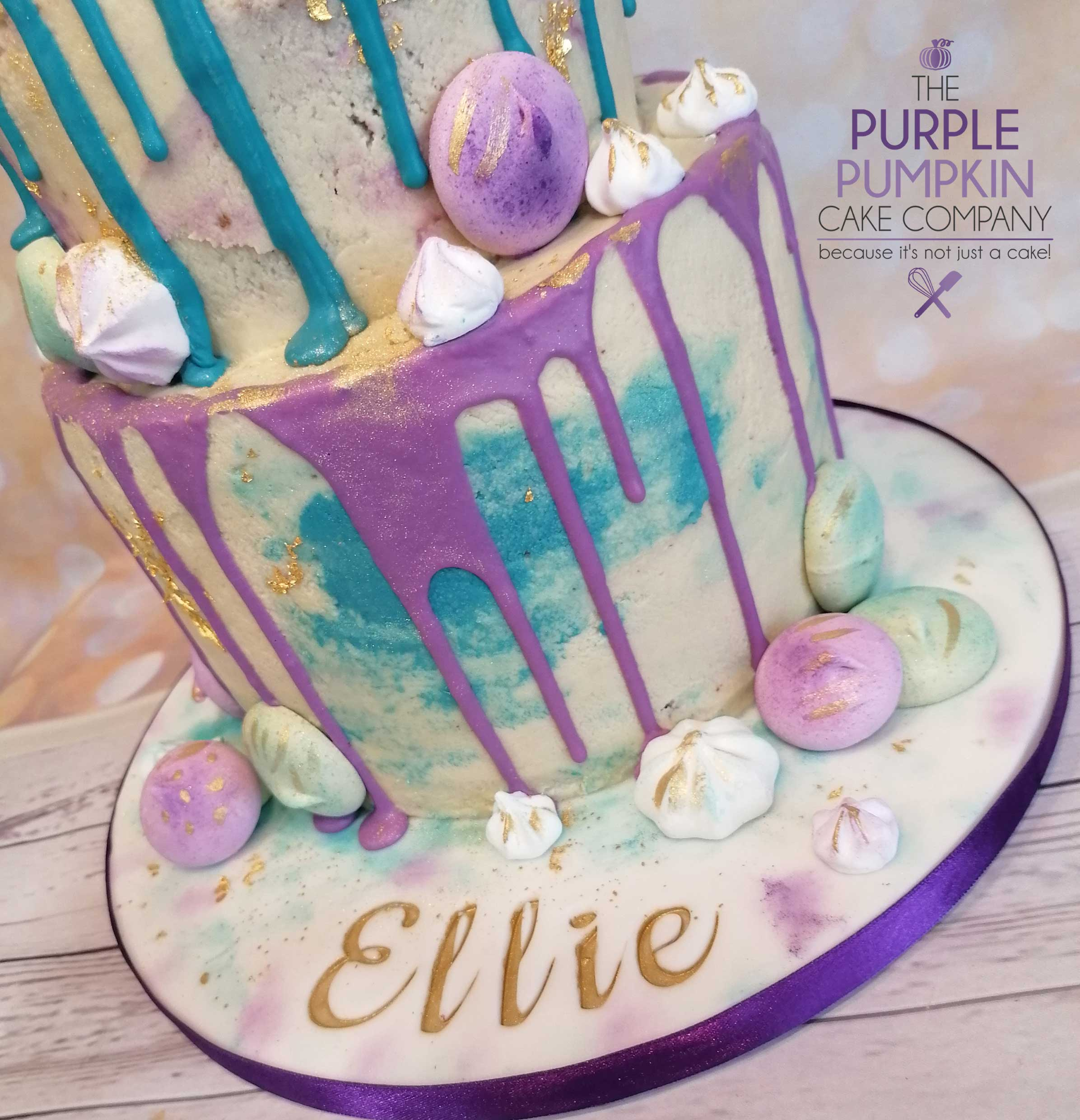 Two tier purple and teal drip cake