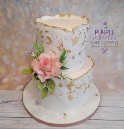 Two tier plaster effect wedding cake