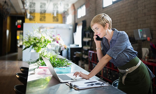 business owner flowers and laptop.jpg