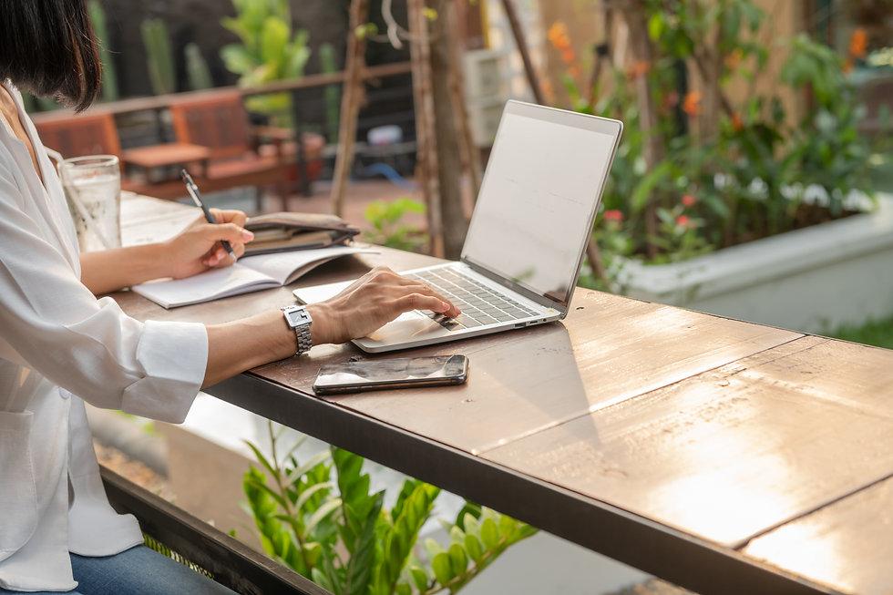 portrait-businesswoman-cafe-using-laptop