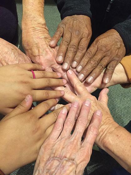 Copy of Refugee and volunteer hands.JPG