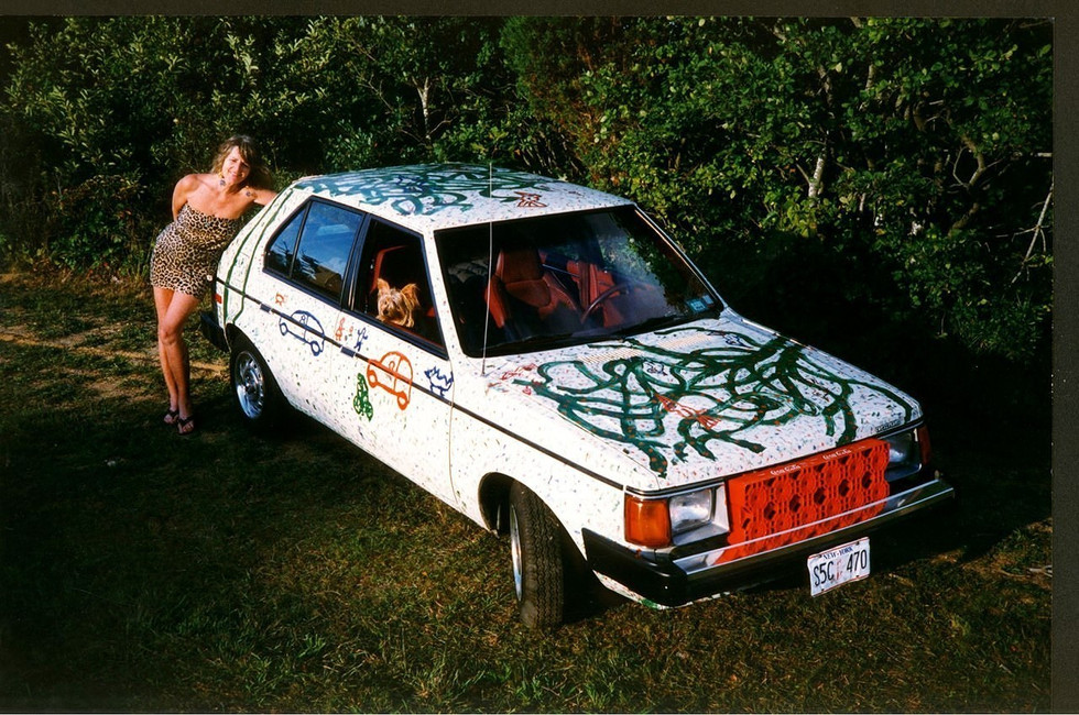 Painting the Dodge in 1992 marine paint on steel.