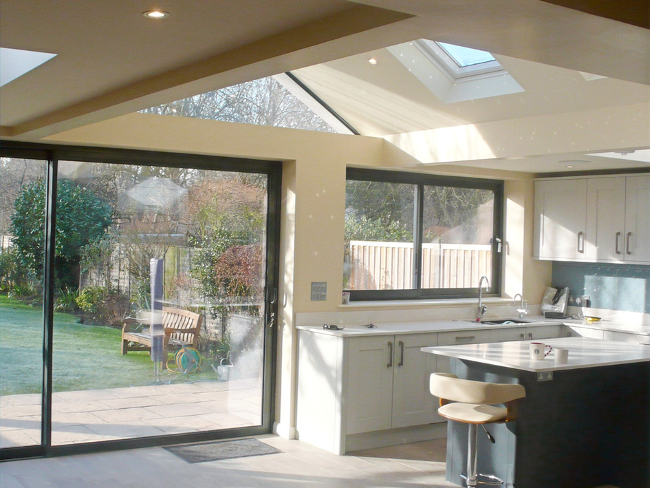 Private house - Surrey : Extensions to front, side and rear - planning and implementation.