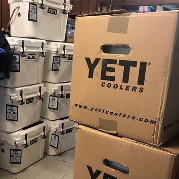 You know you need a bigger shop when you can't move around because of all yeti cooler we are wrapping.jpg