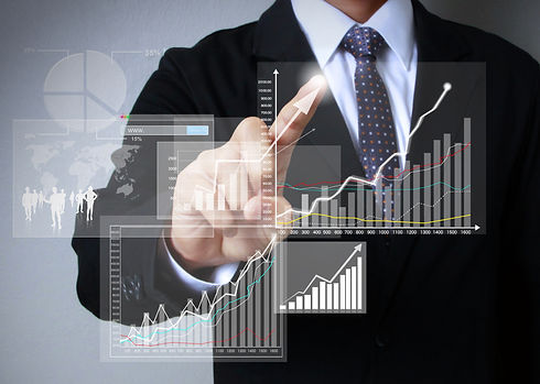 businessman with financial symbols coming from hand_
