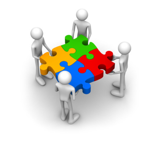 PowerPoint Template: various people sitting at a round table with puzzle  pieces in front (26085)