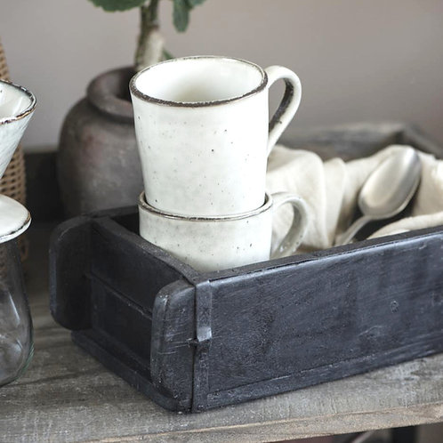 alte Ziegelform aus Holz schwarz