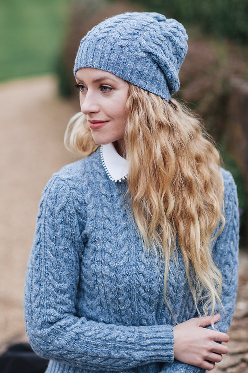 Beautifully knitted cablehat in light blue
