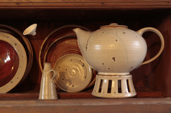 teapot, stove and single flower vase