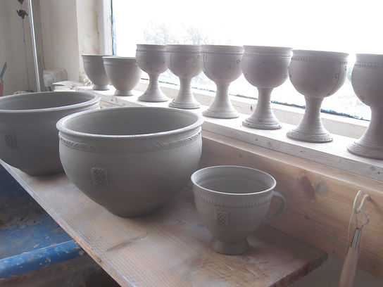 hand made pots waiting to dry