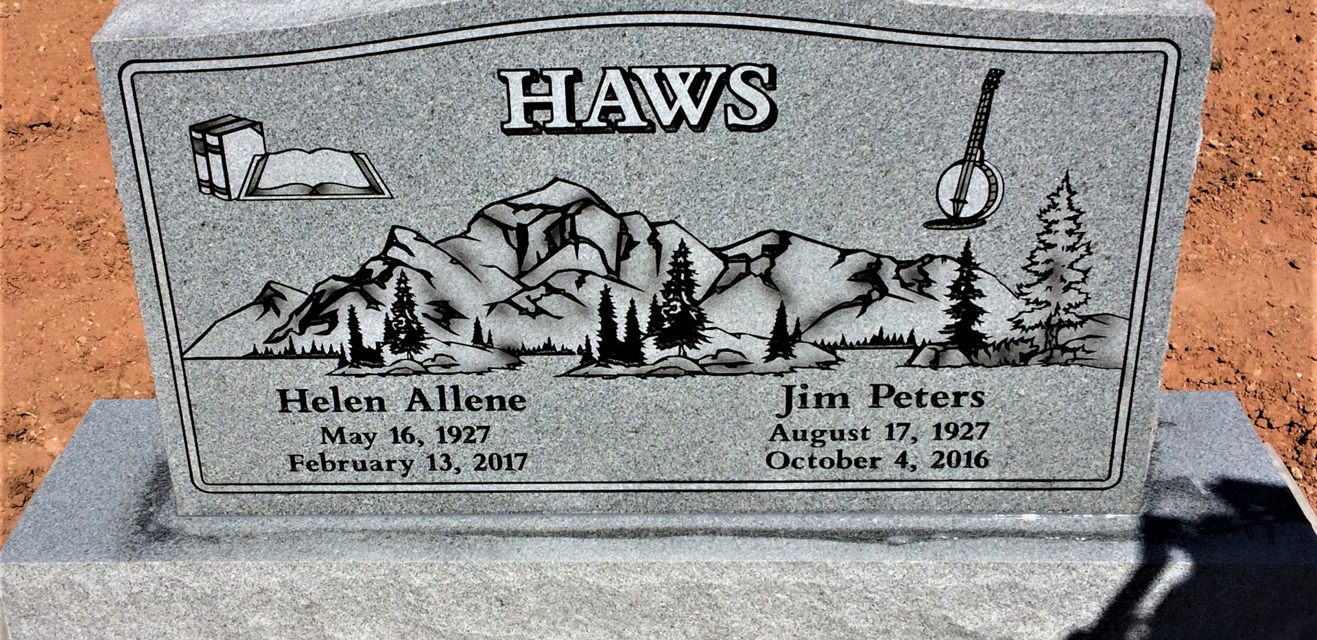 Upright headstone with border mountains