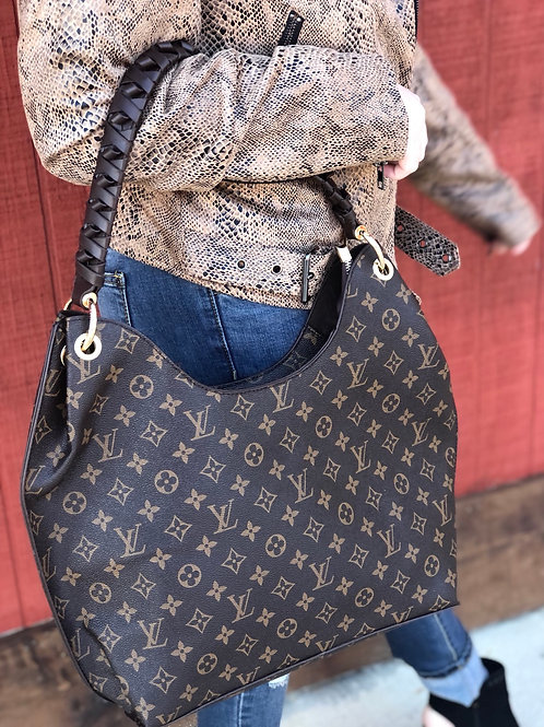 Inspired knotted handle purse