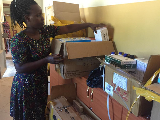 Nashiba unpacking medical supplies