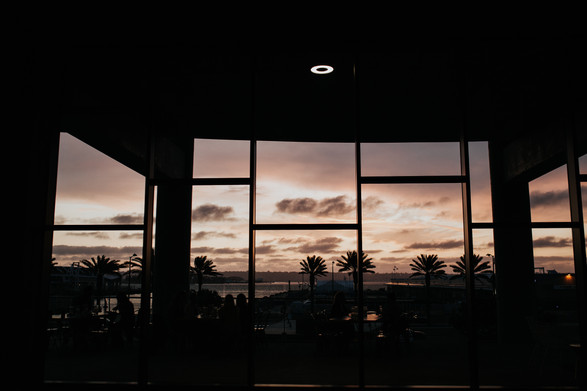 Looking through the floor to ceiling windows at the San Diego sunset