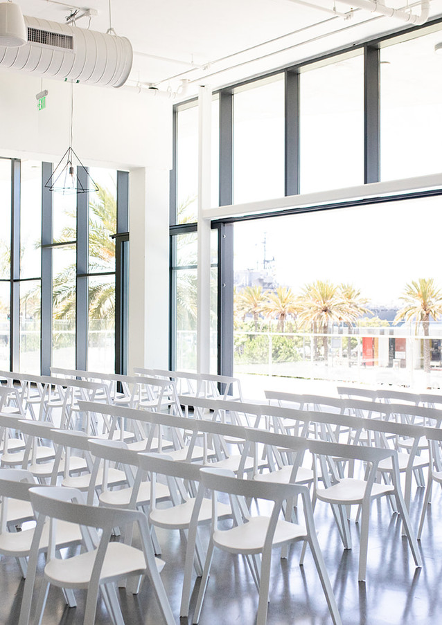 Guests facing the terrace glass railing