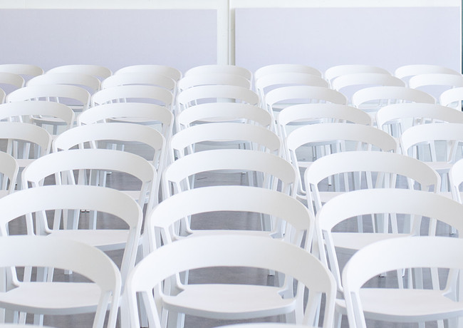 The Lane white rounded-back chairs