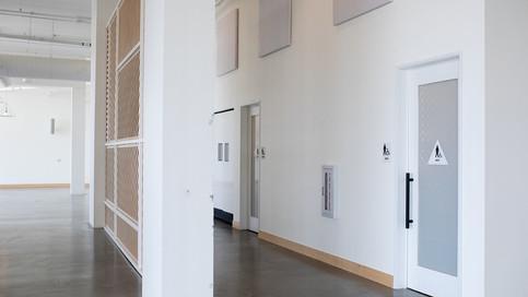 Interior Walkway + Restrooms