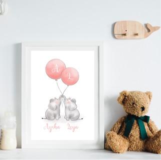 Twin elephants with balloons