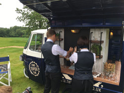 The Tipsy Team pouring a pint