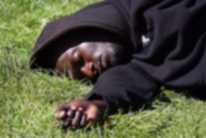 black-man-sleeping-grass-1079099542.jpg