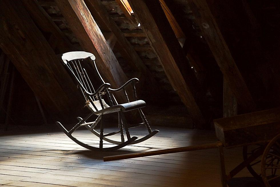 Old rocking chair on a dim attic.jpg