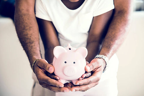 dad-and-daughter-holding-piggy-bank-on-h