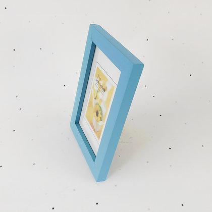 15x10 מסגרת עץ תכלת