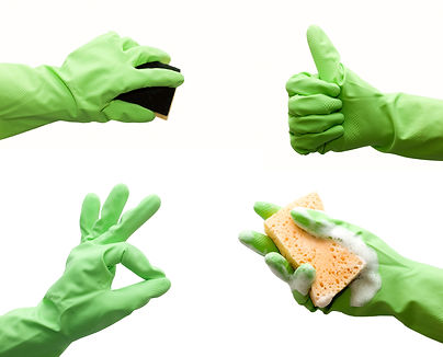 Hand with green glove holding foamy clea