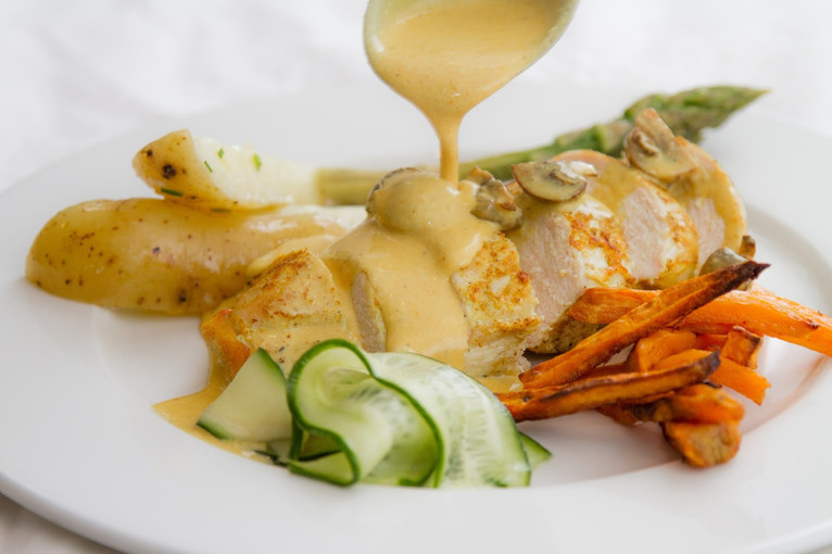 Curried chicken, potatoes two ways, pickled cucumber and garlic asparagus