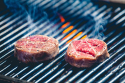 delicious-steak-on-grill-PGWDNQS