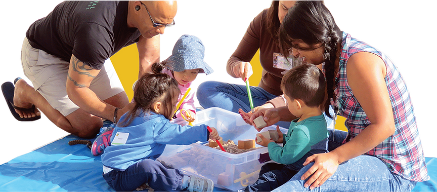 Parents and children playing together with toys