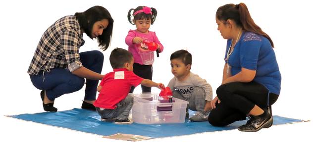 Caregivers and children playing