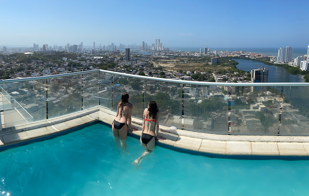 Two girls in a rooftop pool