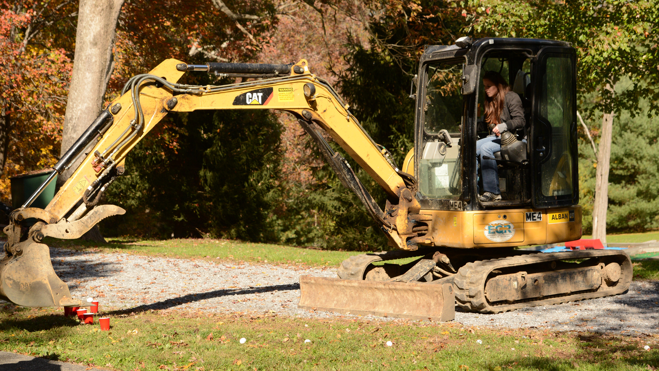 2014 Picnic! Karly is trying to put an egg in a cup using one of our excavators