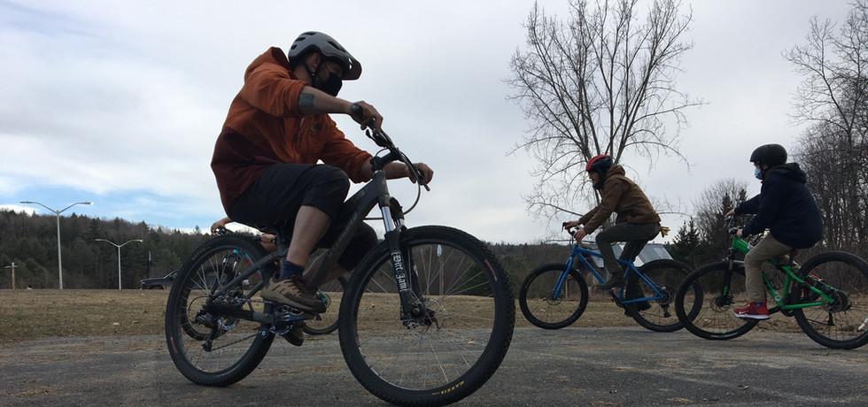 "The biking crew enjoying a game of ""Put Down."""