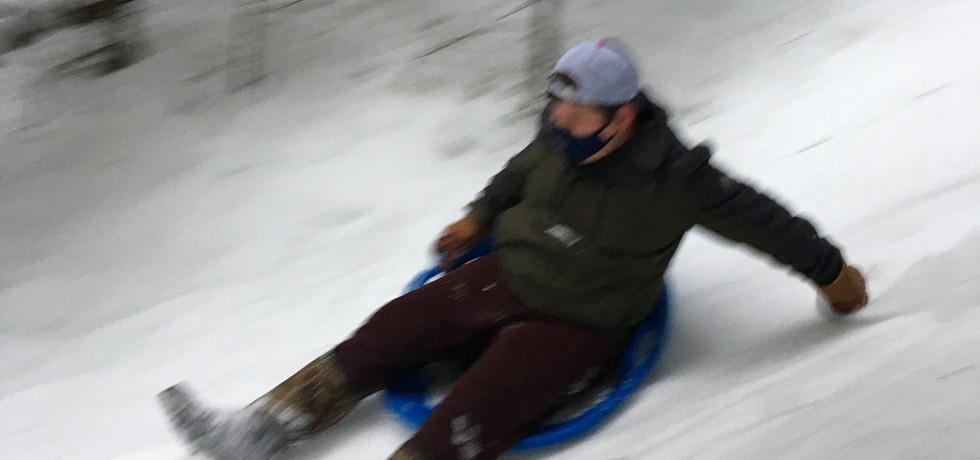Casey zipping down Butt Slide hill!