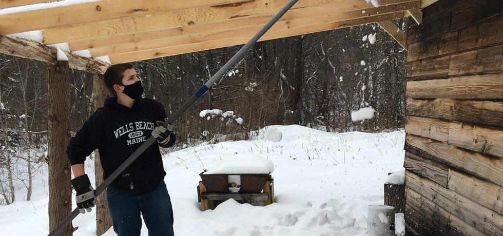 Logan prepping our blacksmithing space.