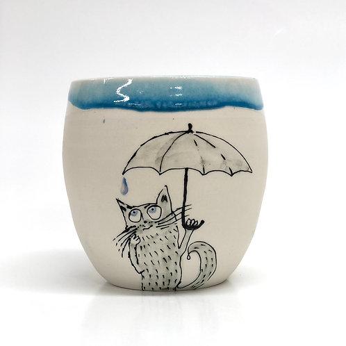 Kitty in a rain