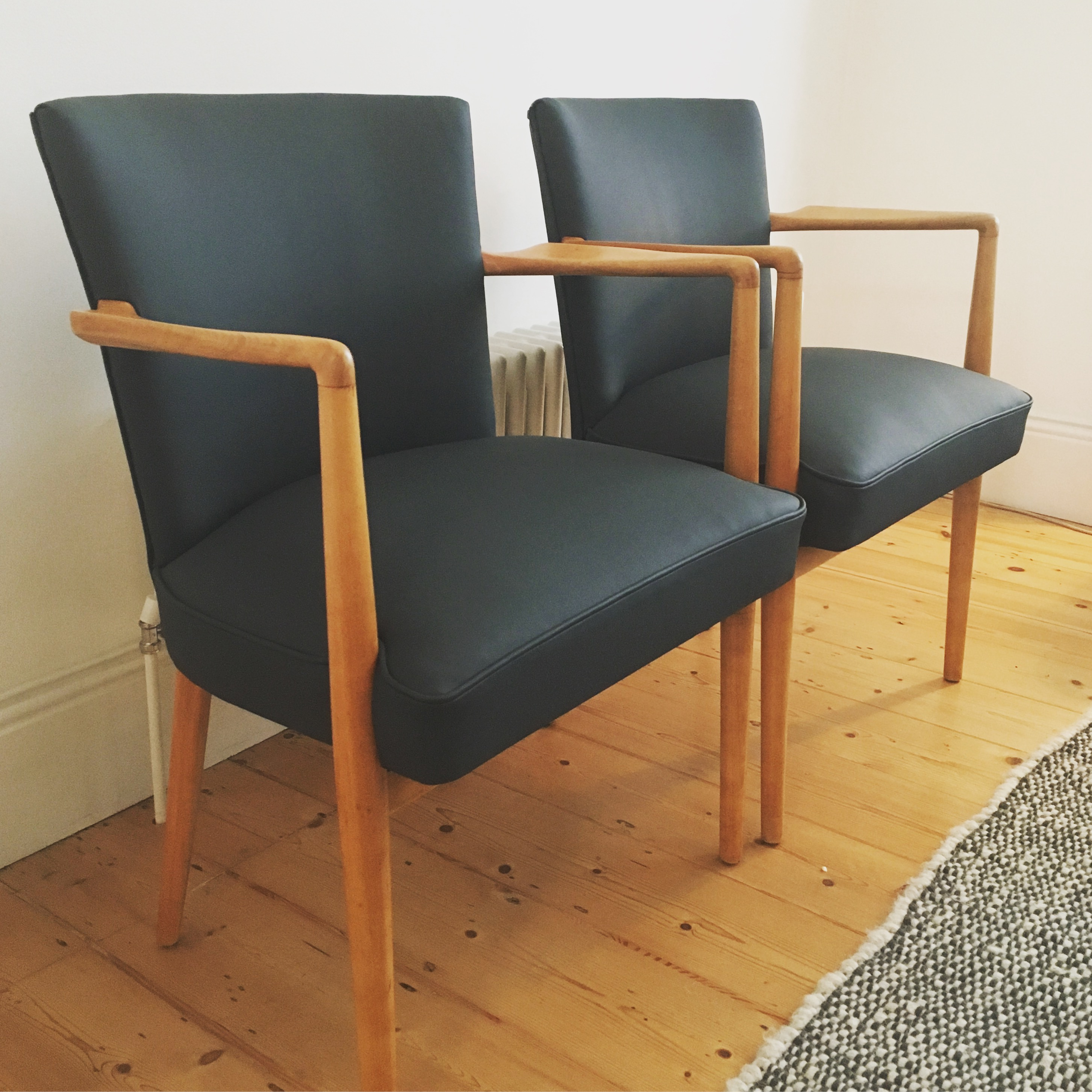 Pair of leather Danish chairs.jpg