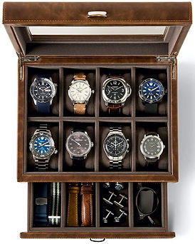 Open wooden box of watches in separate compartments