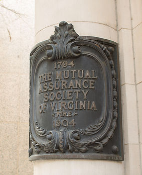 Close up of ornate Mutual Assurance Iron plaque on outside of building