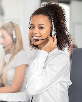 Smiling female phone operator in white blouse and headset