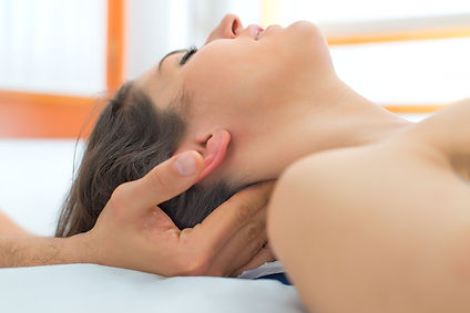 Therapist massaging the neck of woman In