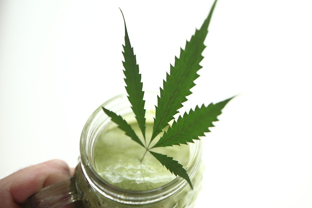 Green Drink in Cup with Marijuana Leaf Sticking Out